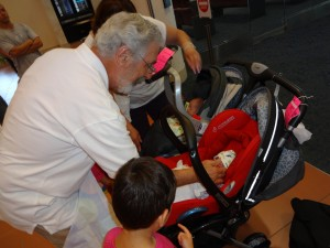 Grandpa meets the new twins for the first time